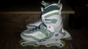 Women's size 8 in line rollerblades with bag