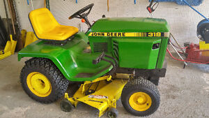 1984-318 John Deere with attachments