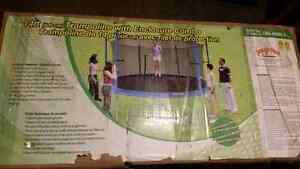 Brand new trampoline with enclosure