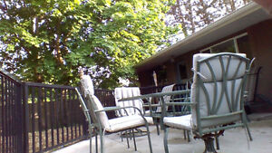 """Patio tabel 60"""" glass top, 4 chairs, 2 swivel chairs, 3 cushions"""
