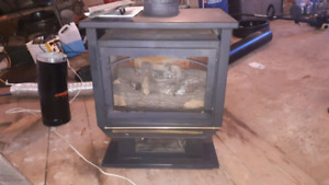 free standing propane stove went with wood