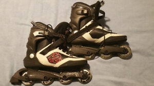 Mens Roller Blades, New, never used.