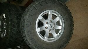 4 - 17 inch factory nissan wheel with nitto tires for sale