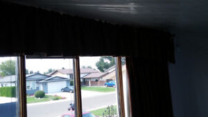 Brown drapes with liners c/w rods and valance. Excell cond
