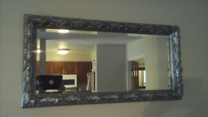 Silver coloured rectangular mirror (31 inches W X 15.5 inches H)