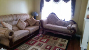 High end designer fabric sofa and love seat. good condition