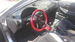 NRG steering wheel with quick release and hub