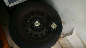 set of 4 tires on steel rims, $80
