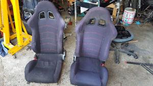 Two reclinable bucket seats