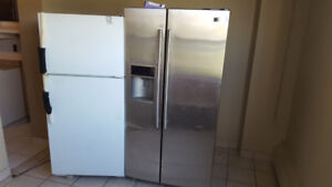 Moving sale.... two refrigerators and electric stove $200