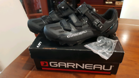 Cycling shoes with cleats plus overshoes