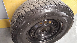 4 Black RIMS with Blizzak Winter on 255 75 R17 Jeep Wrangler