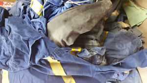 Mountain of coveralls for sale $20 each or discounts on multiple