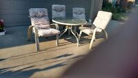 PATIO TABLE AND 4 PATIO CHAIRES