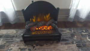Pleasant Hearth Electric Log Set with Fireback.