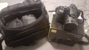 Nikon p600 coolpix digital camera with tripod and padded case