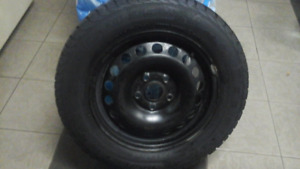 4 WINTER TIRES 195/65R15 WITH RIMS $350. Negociable