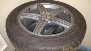 Snow tires and rims for a Mercedes SUV