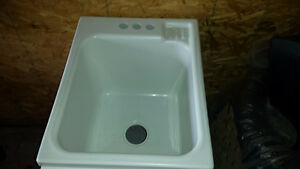 Laundry sink with faucet and accessories