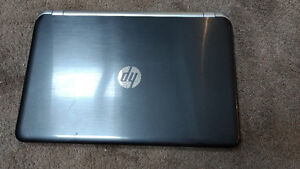 Hp Laptop with Charger working perfectly.Text 9058727365