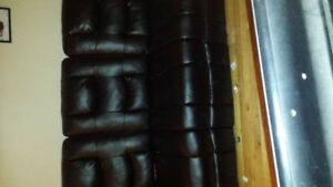 Black leather reclining couch , only 4 months old . Paid 1,200$
