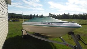 Looking to trade boat for a snowmobile of equal value or cash