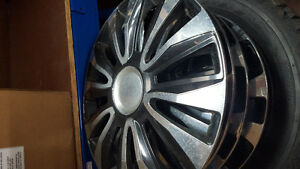4 firestone winterforce tires for sale on rims w/hubcaps!!