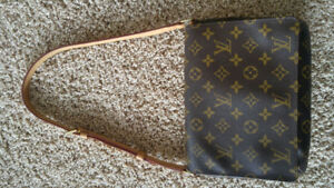 Authentic Louis Vuitton Tango Short Strap Monogram Handbag