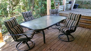 Large glass top patio table and 4 fantastic chairs