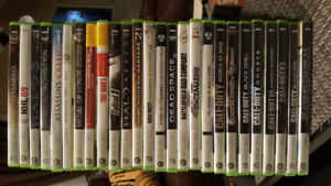 X box 360 with bunch of games.