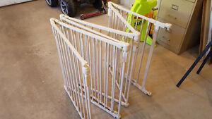 Lightly used folding baby gates 12 and 16 foot gates