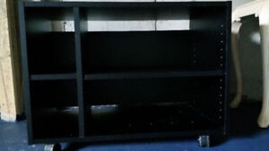 1 used black shelf on wheels for $30; can be used as TV stand.