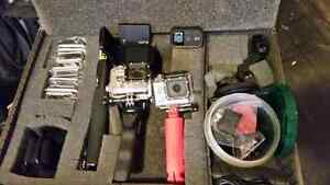 2 GoPro cameras, mounts, cases, remote, screen, extra battery