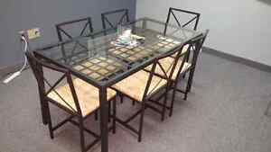 Glass top table and 6 chairs $99