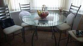 Glass top table and four chairs