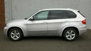 """Oem bmw x5 style 210 18"""" rims with goodyear snow tires"""