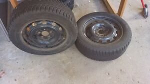 16 inch snow tires on rims used one season London Ontario image 1