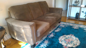 Leon's Olive Green Sofa in Like New Condition