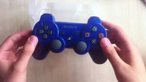 BLACK AND BLUE DUEL SHOCK WIRELESS PS3 CONTROLLERS FOR SALE