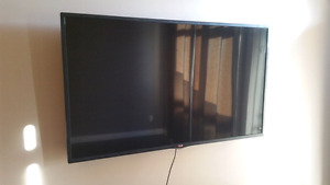 """55"""" LG flat screen Smart TV WITH wall mount!!"""