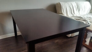 Espresso coloured table with seating capacity up to six persons