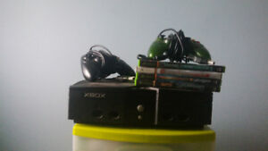 Original x box, 2 controllers and 4 games