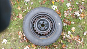 185/65r14 Firestone Winterforce tire on rim excl cond  $25 obo