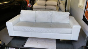 White leather sofa bed with ottoman