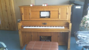 Player Piano with music rolls