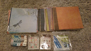 200 pieces of scrapbook paper and BNIP stickers/embellishme