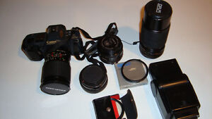 T70 Canon camera.c/w accessories including flash, carrying case
