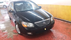 Kia Spectra 2009 low kms( 84000) in mint condition.