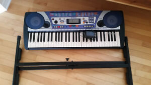 Portable electronic keyboard and books