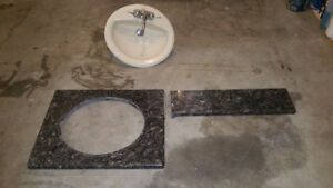granite bathroom countertops with sink and faucets
